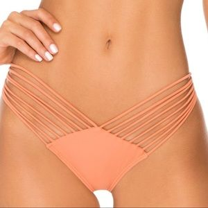 Luli Fama strapping Brazilian rouched bottom